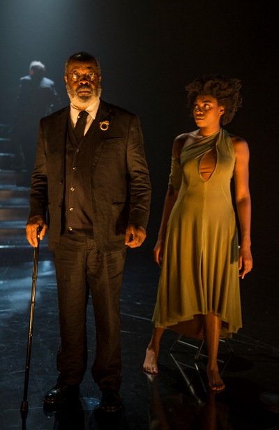 Cassandra (Adrienne Walker) gets her first glimpse at a citizen (Alfred H. Wilson) of Mycenae. (Michael Brosilow)