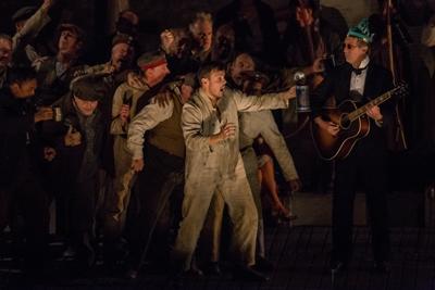 "David Portillo lights up the tavern scene in ""Wozzeck"" at Lyric Opera Chicago. (Andrew Cioffi)"