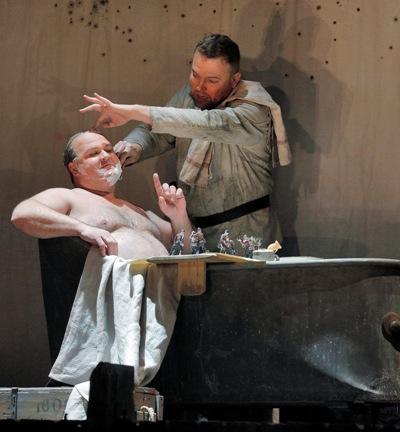 The Captain (Gerhard Siegel) criticizes Wozzeck (Tomasz Konieczny). (Cory Weaver/Lyric Opera Chicago)