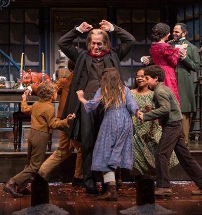 Lots of children in the cast help Scrooge finally learn his lesson. (Liz Lauren)