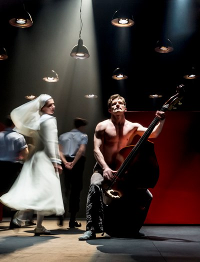 In a dreamlike episode, Isabella (Anna Khalilulina) whirls around her condemned brother Claudio (Petr Rykov) as he plucks a double-bass. (Johan Persson)
