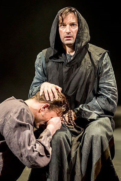 The condemned Claudio (Petr Rykov) seeks solace from the Duke disguised as a friar (Alexander Arsentyev). (Johan Persson)