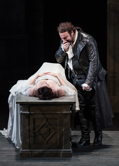 Romeo (Joseph Calleja) grieves over his apparently dead Juliet (Susanna Phillips). (Todd Rosenberg)