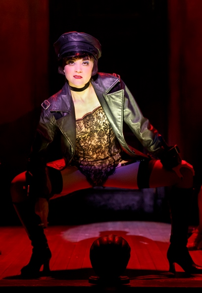 Sally Bowles (Andrea Goss) gets down with a hard-edged number at the Kit Kat Club. (Joan Marcus)