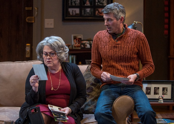 As Cal (Jeff Parker) watches, Katharine (Cindy Gold) looks through old photos of her dead son. (Michael Brosilow)
