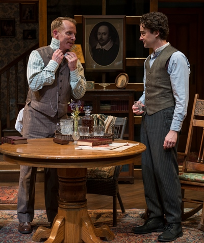Brothers Jamie (Dan Waller) and Edmund (Michael Doonan) sneak a drink before dinner. (Michael Brosilow)