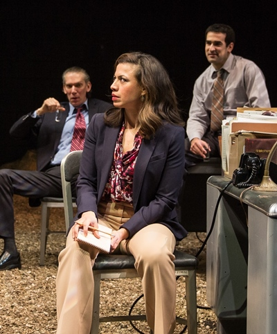 An anxious reporter (Sandra Delgado) gets a hard time from cynical cops (Lawrence Grimm and Demetrios Troy). (Liz Lauren)
