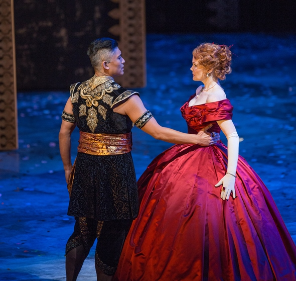 In dancing, the King (Paolo Montalban) reminds the teacher (Kate Baldwin), one hand goes around the waist. (Todd Rosenberg)
