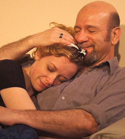 A peaceful moment in a household storm for Maggie (Abby Dillion) and Mick (Adam Bitterman). (Jan Ellen Graves)