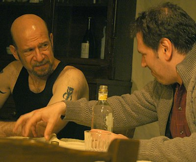 Maggie's father Thomas (Mark Pracht, right) gives Mick (Adam Bitterman) his version of how things are. (Jan Ellen Graves)