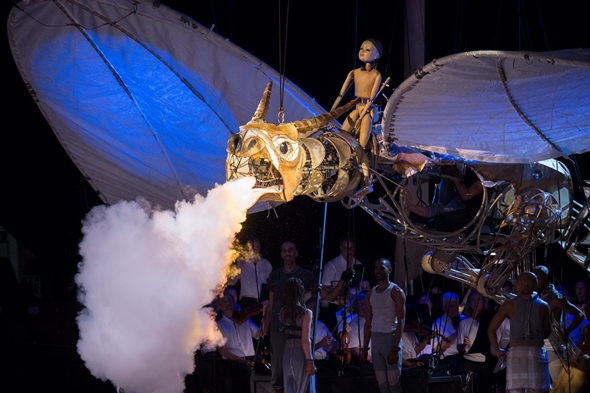 A wooden puppet mounts the smoke-breathing dragon in final triumph. (Patrick Gipson/Ravinia)