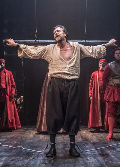 Antonio (Dominic Mafham) prepares to meet Shylock's bond. (Marc Brenner)