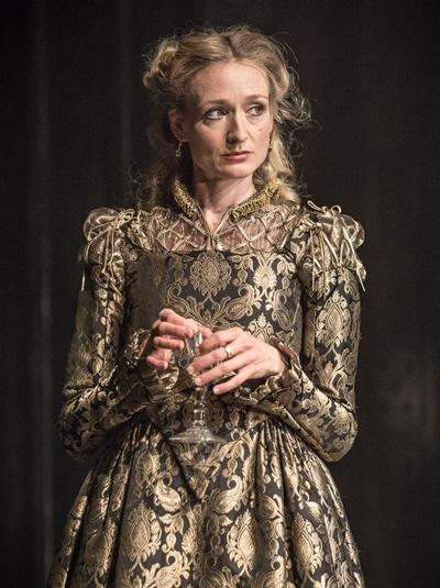 Portia (Rachel Pickup) disguises herself to save the merchant Antonio. (Marc Brenner)