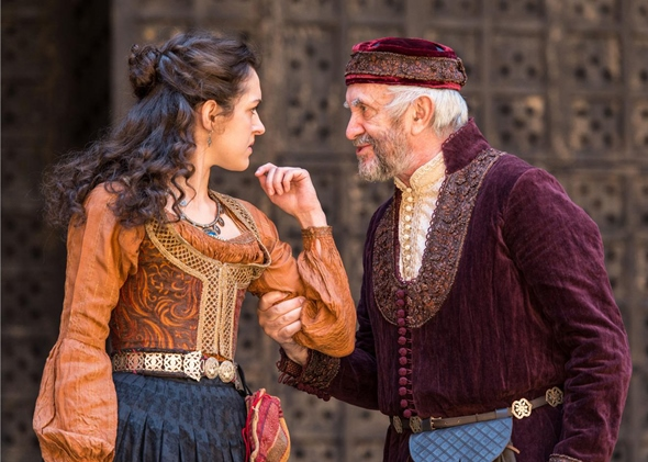 Shylock (Jonathan Pryce) cautions his daughter Jessica (Phoebe Pryce) to stay within their house. (Marc Brenner)