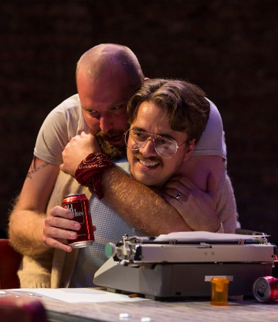 Lee (Joseph Wiens) is attached to his beer while Austin (Kevin Viol) sticks to his typewriter. (Michael Brosilow)