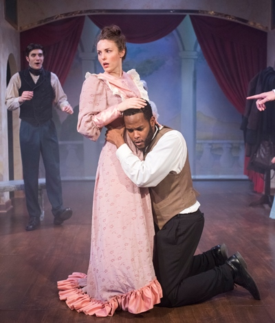As Othello, Ira Aldridge (Brandon Greenhouse) shows Desdemona (Tuckie White) how they should embrace. (Dean La Prairie)