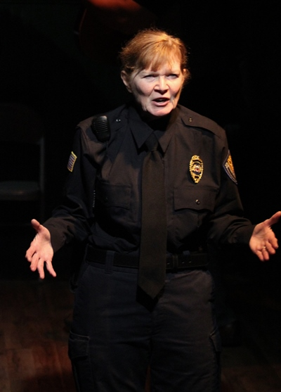Officer Darla London (Melissa Riemer) relates the sad tale of Bobbie Clearly. (Gregg Gilman)