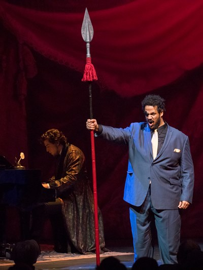 The composer (Jesse Case, at the piano) envisions his über-god Wotan (Jonah D. Winston). (Todd Rosenberg)
