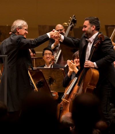 Principal cello John Sharp, left, exchanges compliments with assistant principal Kenneth Olsen. (Todd Rosenberg)