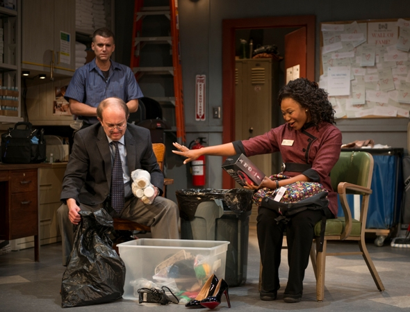 """Housekeeping camaraderie revolves around the lost-and-found bin in """"The Fundamentals"""" at Steppenwolf. (Michael Brosilow)"""