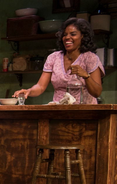 Charlesetta (Tyla Abercrumbie) supplies drinks and affection at her little cafe. (Michael Brosilow)