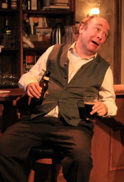 Jack (Brad Armacost) blusters and laughs and drinks and drinks. (Emily Schwartz)