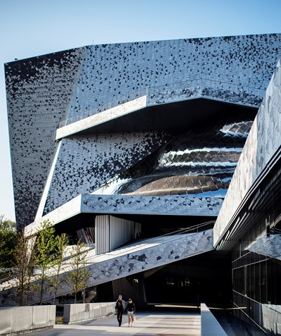 From the outside, the Paris Philharmonie presents a complex image of angles and terrraces.