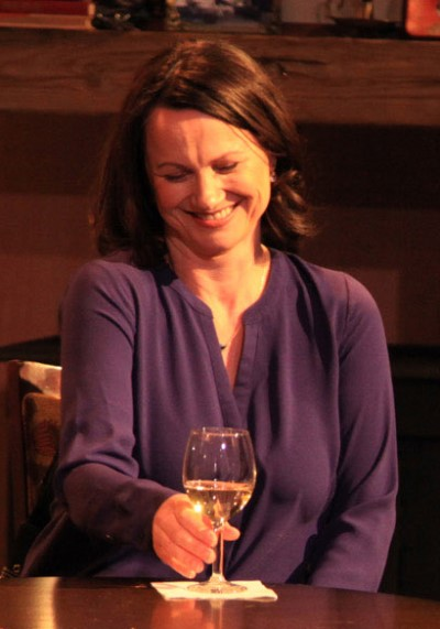 Newcomer Valerie (Sarah Wellington) loves the old stories, though they're told in rough language. (Emily Schwartz)