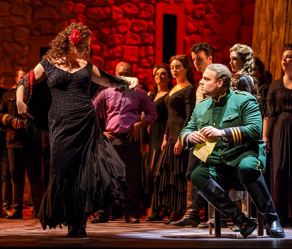 Carmen (Ekaterina Gubanova) works her Gypsy wiles on Don José (Joseph Calleja). (Todd Rosenberg)