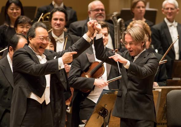 Cellist Yo-Yo Ma and composer-conductor Esa-Pekka Salonen share their joy at the premiere of Salonen's Cello Concerto. (Todd Rosenberg)