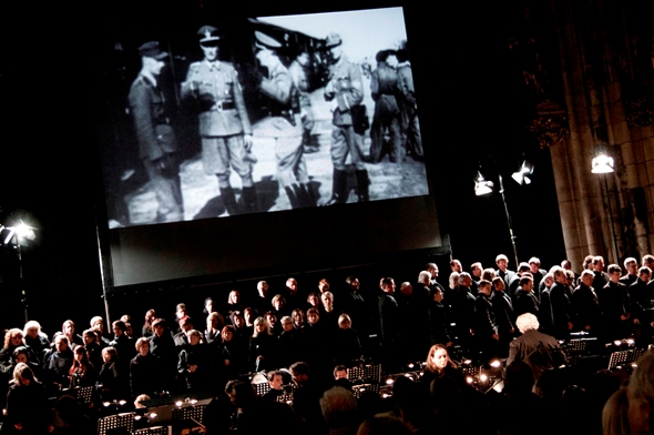 """""""Defiant Requiem"""" blends video clips with the musical performance and narrative. (Josef Rabara)"""