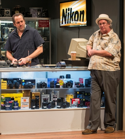 Wheeler (Ian Barford, left) must deal with a depressive shop owner (Troy West). (Michael Brosilow)