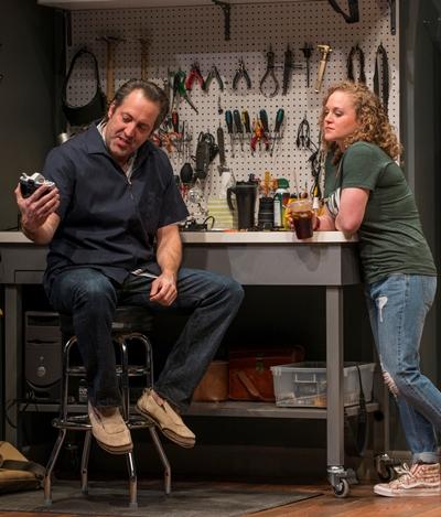 Wheeler (Ian Barford) and Anita (Caroline Neff) are co-workers at a camera shop. (Michael Brosilow)