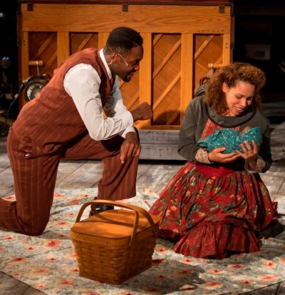 Coalhouse Walker Jr. (Denzel Tsopnang) and Sarah (Katherine Thomas) share a picnic with their infant child. (Michael Brosilow)
