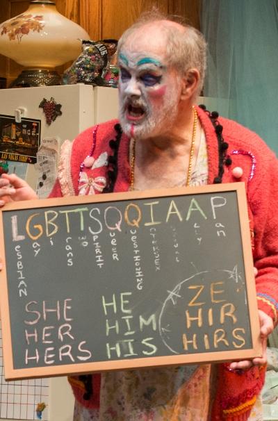 "Dad (Francis Guinan) displays the new gender order. Call it ""Lugabuttsqueehah."" (Michael Brosilow)"
