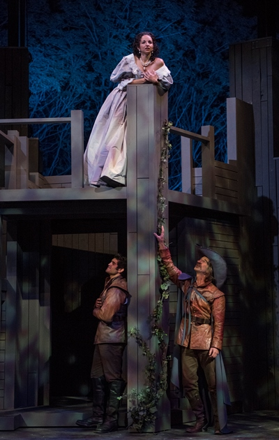 The enchanted Roxane (Laura Rook) listens to the unsuspected Cyrano (James Ridge, lower right) giving voice to the love of Christian (Danny Martinez). (Michael Brosilow)
