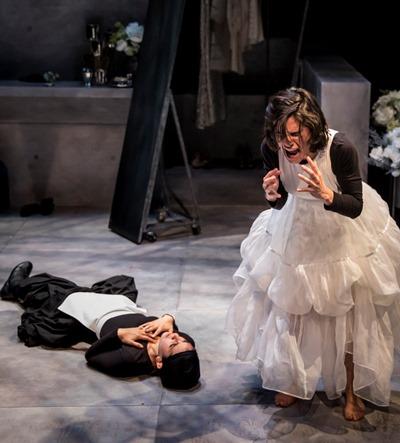 Claire (Melisa Pereyra) convulses in agony over her inert sister Solange (Andrea San Miguel). (Liz Lauren)