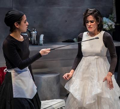 As dominatrix, Solange (Andrea San Miguel) threatens her sister Claire (Melisa Pereyra). (Liz Lauren)