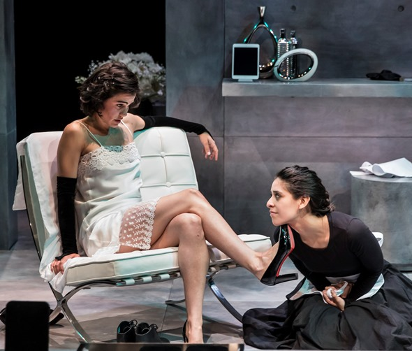 """In """"The Maids,"""" Claiire (Melisa Pereya) acts out as Madame with her sister Solange (Andrea San Miguel) at her feet. (Liz Lauren)"""