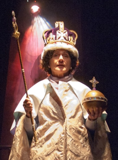 Queen Elizabeth (Janet Ulrich Brooks) remembers the solemnity of her coronation. (Lara Goetsch)