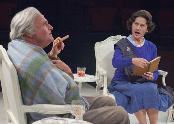 Prime Minister Harold Wilson (Matt DeCaro) enjoys a cigar and a drink with Queen Elizabeth. (Lara Goetsch)