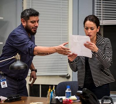 Lucia (Sari Sanchez) sees that she can help Abel (Eddie Martinez) in his quest for promotion. (Liz Lauren)