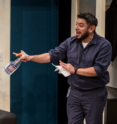Custodian Abel (Eddie Martinez) is ever ready with moral support for Lucia. (Liz Lauren)