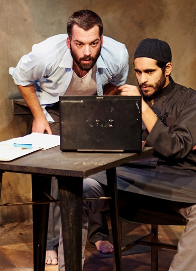 Nick (Joel Reitsma) and Bashir (Owais Ahmed) await the results of their market move. (Lee Miller)