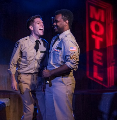 Two soldiers (Will Lidke and Stephen Allen) see possibilities in their traveling companion Violet. (Michael Brosilow)