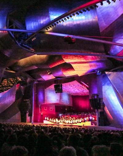 Pritzker Pavilion, in splendorous illumination for a evening concert.