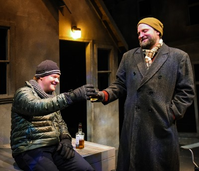 On a cold night, brothers Jamie (Steve Peebles, left) and Rufus (Joseph Wiens) share a toast. (Evan Hanover)