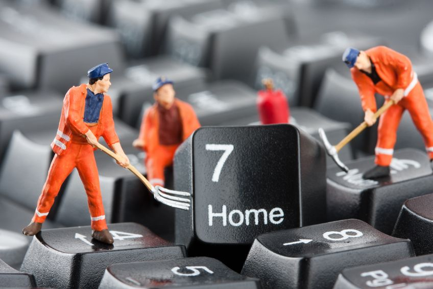 miniature workmen fixing home button