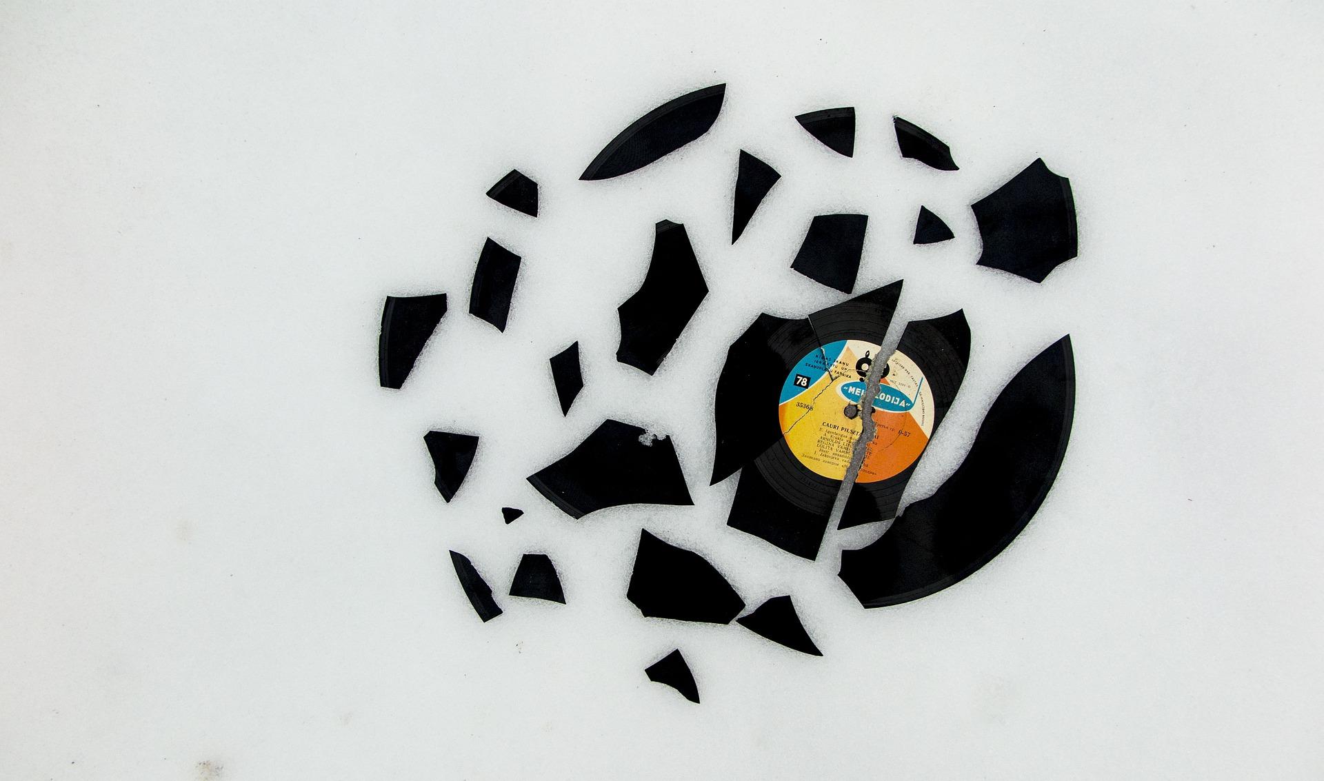 a vinyl record that has been broken into pieces