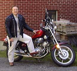 Stewart Donovan, next to a motorcycle